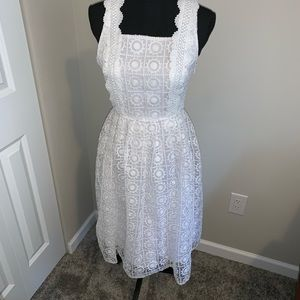 White lace fully lined mid length dress